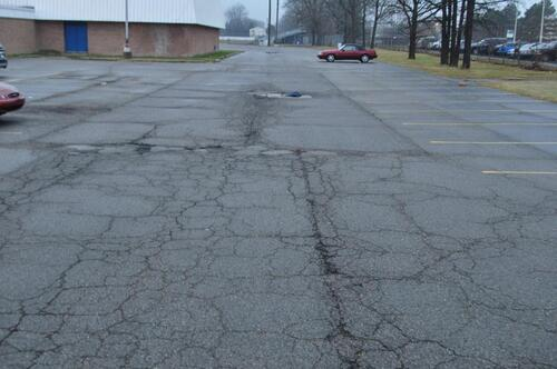 cracked and pitted parking lot